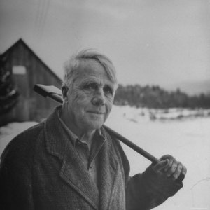 594549~Poet-Robert-Frost-in-Affable-Portrait-Axe-Slung-over-Shoulder-in-Wintry-Rural-Setting-Posters-1